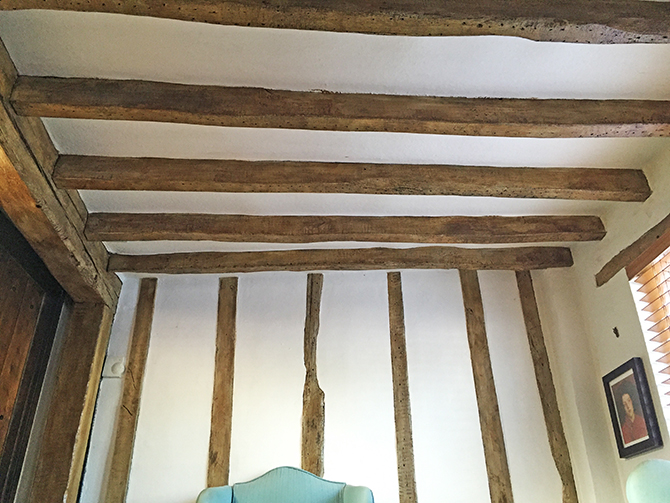 Lightening old oak beams with the minimum of disruption.